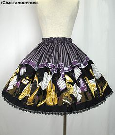 Musical Cat Mini Skirt by Metamorphose Temps de Fille  Brass band cat ミニスカート    2014  Product Number  13043007  Length  45cm (17.7in) + lace  Price  10584    fabric:original Musical Cat print fabric (cotton 100%), tulle lace    style:full shirred waist, comes with lining    size:  length45cm (17.7in) + lace  waist60 - 110cm (23.6 - 43.3in)    comment:Add this cute printed skirt to your already stunning wardrobe!!