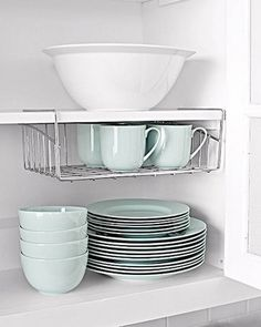 Attach Undershelves in a Cabinet to Take Advantage of Vertical Space - 20 Clever DIY Home Organization Ideas