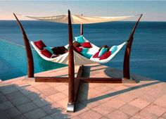 This giant covered hammock--next to a pool AND hanging above the ocean--is such a dreamy reading nook. Plus, it has room for more than one bookworm!