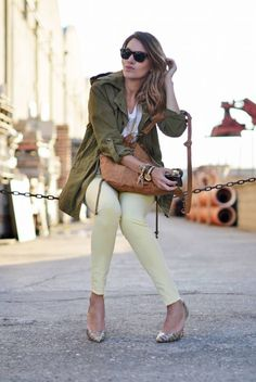 pale yellow jeans, parka, arm party, cool jumper with embedded cross, heels