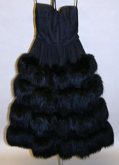 Black evening dress with tiered fur skirt, by Norman Norell for Traina-Norell, American, 1953.