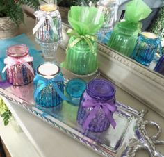 Give the gift of fragrance, beautiful Mercury Glass Jars are filled with scents of the season and include ribbon and sheer bags - Set of 5!  H202640 http://qvc.co/-Shop-ValerieParrHill