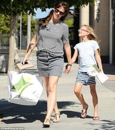 Hand-in-hand: Jennifer Garner's daughter Violet looks set to follow in her footsteps if the youngster's look on Tuesday was anything to go by as the eight-year-old looked like a mini-me version of the 42-year-old actress
