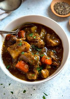 St. Patrick's Day doesn't mean just serving up corned beef. This Guinness Irish Stew is a great alternative with an incredibly rich, thick broth. Lamb or beef get layered with flavors due to a slow braise in Guinness beer, vegetables and herbs. Plus it's made all in one pan! #stew #Irish #Guinness Irish Stew, Irish Recipes, Beef Recipes, Healthy Recipes, Corned Beef Stew, Guinness Beef Stew, Side Dish Recipes, Dinner Recipes