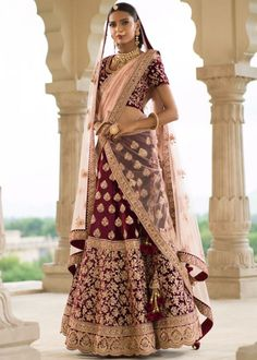 The maroon bridal lehenga paired with exclusive floral dori and resham embroidery blouse along with peach net dupatta to furnish it a sophisticated look for Only/- . COD available assured Quality . Rajasthani Lehenga Choli, Bridal Lehenga Choli, Indian Lehenga, Indian Wedding Wear, Indian Bridal, Indian Wear, Indian Dresses, Indian Outfits, Indian Clothes
