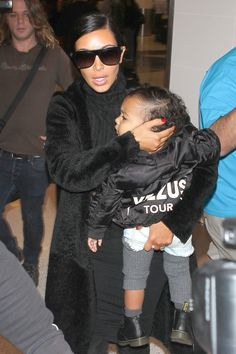 Kim Kardashian and North West at LAX on Nov. 5, 2014, in Los Angeles. Getty -Cosmopolitan.com