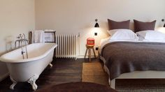 The Olde Bell is a beautiful boutique hotel in. Chic Retreats members receive hotel discounts and other benefits when booking The Olde Bell online. Bedroom With Bathtub, Small Boutique Hotels, Inglenook Fireplace, Fireplaces, Feng Shui House, Property Design, Beautiful Bedrooms, Hurley, Relax