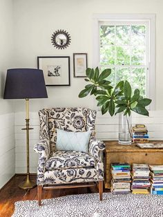 Love the pattern of this armchair (but not the color of wood of that trunk or the spotted rug).