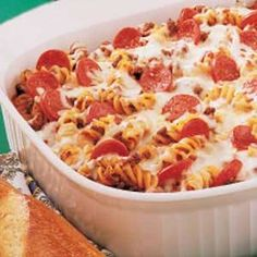 "Pizza Pasta Casserole Recipe ...--~~Pepperoni provides the zip in this pizza-flavored casserole that kids of all ages will enjoy. ""Serve it with a tossed salad and garlic toast, and you'll have a winner every time,"""