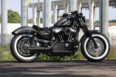Customized Harley-Davidson Sportster Forty-Eight with new brass grips&controls, exhaust and leather saddle. Built by Thunderbike Customs Germany