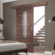 Bespoke Thruslide Surface Portici Walnut Glazed - Sliding Door and Track Kit - Aluminium Inlay - Prefinished - Lifestyle Image. #conemporarydoors