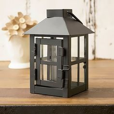 Hanging/Tabletop Decorative Small Black Metal Lantern Tea Light Candle Lantern: This tea light candle lantern will bring the fun into your place.Solo or grouped,these mini metal candle lanterns will brighten your place.  Add romance,charm and beauty to your decoration with these mini metal candle lanterns.The light from the LED tea light candle through the windowpanes will cast a hazy band of light around and enhance your romantic moods.