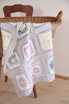 Love the colors of this, but love the idea of using one granny square sewn onto a front of a pillow!