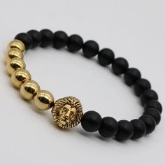 Beautifully handcrafted, this stunning beaded Lion head stretch men's bracelet is available in 4 beautiful color and metal variations. - Fits all wrists - Natural Black Onyx beads with a diameter of 7