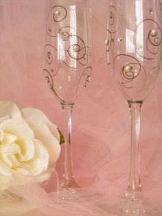 painted wedding champagne toasting flutes with pearls and Swarovski crystals can be customized in your wedding colors. $35.00, via Etsy.