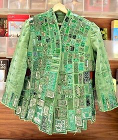 Now this is a way to recycle technology! This photo is amazing, and really shows what imagination and determination can really create. This is a 'green' (literally) coat made of recycled transistors from computer memory boards.