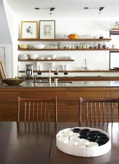 Mid-Century Kitchen with open shelving... This would be good around a cooking station for mixing bowls, spices and cook books that take up a lot of storage
