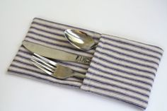 Set your table in style with these napkin holders. Made from a sturdy, cotton, blue and cream striped fabric, they give every day meals a special