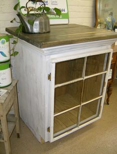 Old windows become cabinets with the help of scrap wood!  Create a cabinet from scrap pieces of woods and then add a window as a door.  Cabinet can be extra storage in the kitchen, a places to store tools in the garden or a place to protect flowers during the cold months!  We currently use ours as a display in the Habitat ReStore.  What will YOU store with your cabinet? habitatpittco.org...