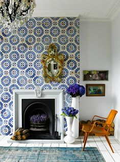 wallpaper / rug / chandelier / flowers in the fireplace / I love 100% of everything about this // image: Catherine Gratwicke