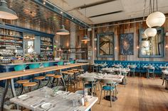 Le Bistrot Pierre, Torquay Design: Gillespie Yunnie Architects and Holly Keeling Interiors. Features: Factorylux industrial shades in the restaurant on the ground floor of the art-deco inspired Abbey Sands complex in the heart of Torquay on the English Riviera.