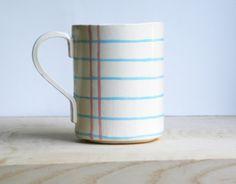 Notebook paper ceramic cup.