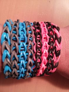 My nieces are hooked! Four Rainbow Loom bracelets: Two Double Single Chains and two Triple Single bracelets.