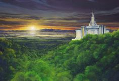 "A breathtaking sunset view of the Bountiful Utah Temple, which captures a ""bench"" perspective of the mountains as well as the dramatic reflection of the Great Salt Lake."