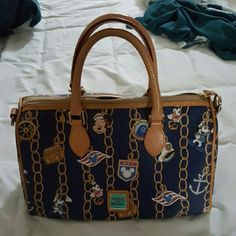 Disney Dooney and Bourke Cruise line bag Great shape. No wear, cracking or scuffs. I do not have the strap. Bags Satchels
