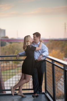 These two are just so natural together and their love just shows. #Nashville #engagement #photos #wedding #photographer #planning #beautiful #sweet #romantic #park #riverfront #pedestrian #bridge #downtown