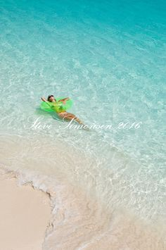 Katy Day relaxing in the clear water Trunk Bay Virgin Islands National Park St. John, U.S. Virgin Islands.