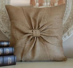 burlap pillow...used shoe canvas and cotton for around bow, turned out great