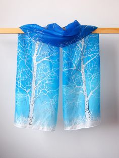 Hand painted silk scarf Birches by Luiza Malinowska MinkuLUL Silver birches on a blue background, on natural silk. On Etsy:https://www.etsy.com/listing/220673991/silk-scarf-birch-scarf-handpainted-silk?ref=shop_home_active_3 #minkulul #silkscarf #birch