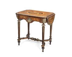 Lot. 239. This is a spectacular table, particlarly and the lower lovel: A Napoleon III gilt bronze mounted burr yew, tulipwood, amaranth and marquetry side table. guide £6-800 Bonhams 08/09/15