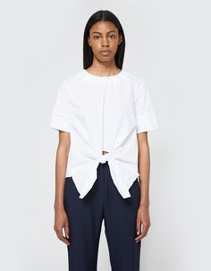 Modern blouse from Stelen in White. Round neckline. Short sleeves with layered cuff. Tie detail at front hem. Darting at waist. Horizontal dart at back. Casual fit.    • Poplin  • 100% cotton  • Hand wash cold