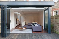 Bernard Gardens - granit Architects. - Folding doors to Living room. Neutral entertaining space.
