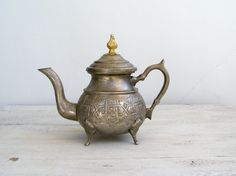 Ornate Oriental Teapot, Silver and gold pitcher, Vintage teapot, Retro kitchenware, collectible kitchenware, Restaurant decor, Kitchen Disp. $48.00, via Etsy.