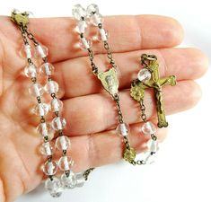 Vintage Catholic Rosary Faceted Clear Glass Beads Mary and Jesus Spacer Medals Lovely rosary with multi-faceted clear glass beads. The highlight here are the elegant spacer medals that punctuate each side of the pater medals - they featur Rosary Catholic, Catholic Gifts, Religious Gifts, Diy Rosary Necklace, Mary And Jesus, Letter Beads, Czech Glass Beads, Clear Glass, Virgin Mary