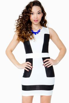 A major showstopper! This fitted sheath dress features a colorblocked front and a round neck.