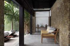 The veranda in front of the master bedroom, furnished with a traditional Indonesian daybed, provides more casual seating