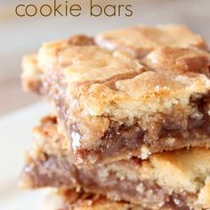 Cake Mix Cookie Bars Six Sisters' Stuff These Cookie Bars Are The Perfect Blend Of Soft And Crunchy. The Chocolatey Peanut Butter Middle Tastes Great Mixed With The White Cake Mix Base Cake Mix Desserts, Cake Mix Recipes, Köstliche Desserts, Dessert Recipes, Bar Recipes, Bar Cookie Recipes, Picnic Recipes, Picnic Ideas, Health Desserts