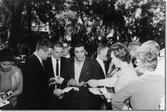 On Location Shooting Started At Napa, California , November 9th 1960. Elvis signs autographs on location for the picture 'Wild In The Country'.