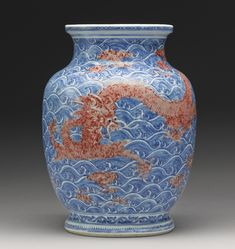 AN UNDERGLAZE BLUE COPPER-RED CYLINDRICAL 'DRAGON' VASE QING DYNASTY, 18TH CENTURY Height 11 5/8  in