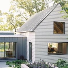 I can never decide which I love most - a white or dark charcoal house. This is the best of both worlds and a look I could love forever. Where do you fall on the exterior paint color discussion - light or dark? Charcoal House, Modern Barn House, Modern Farmhouse Exterior, Next At Home, Residential Architecture, Architecture Details, House Colors, Curb Appeal, Exterior Design