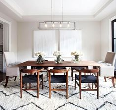 Large rug in dining room for a cozy space