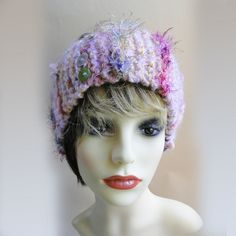 This eye catching chunky head band is hand knitted in multi coloured pink yarn with hints of purples and yellows.  This girly headband is finished off with a variety of interesting fancy eylash yarns and hand made braids with multi-coloured pearl buttons added as a detail. Stand out on the ski slopes this season with our luxury, funky chunky ski headbands Winter Headbands, Ski Slopes, Modern Hippie, Handmade Headbands, Unique Cards, Pearl Color, Yarns, Hand Knitting, Purple