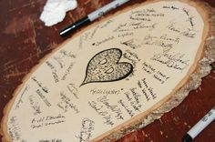 What a wonderful guestbook idea and great way to carry the wood through one more aspect of the wedding.