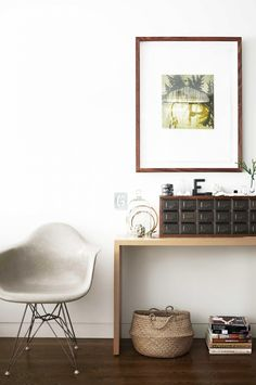 Eclectic décor pieces with modern white chair and framed art