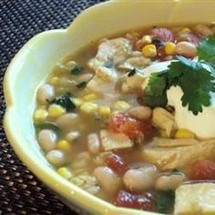 """Slow Cooker White ChiliI """"It was different than most white chilis I have had in the past and I actually liked it better. The use of the green salsa gave it a nice depth of flavor."""""""