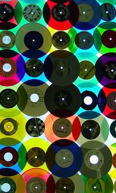 Bright lights behind translucent colorful vintage vinyl records = LOVE! A future DIY project for me for sure.